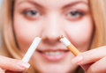 Addiction girl breaking cigarette quit smoking closeup of young woman determined the studio shot Royalty Free Stock Photography