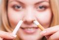 Addiction. Girl breaking cigarette. Quit smoking. Royalty Free Stock Photo