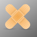 Adhesive bandage  on grey background. Royalty Free Stock Photography