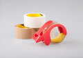 Adhesive tapes and holder dispenser isolated best for wrapping box or others the image Royalty Free Stock Photo