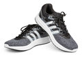 Adidas running shoes, sneakers or trainers isolated on white Royalty Free Stock Photo