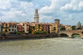 Adige river in verona ponte pietra with other monuments along the a beautiful city northern italy Royalty Free Stock Photo