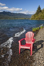 Adirondack chair by lake empty on the shore of quinault olympic national park Royalty Free Stock Photo