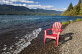 Adirondack chair by lake empty on the shore of quinault olympic national park Royalty Free Stock Photography