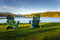 Adirondack Chairs in front of a Lake Royalty Free Stock Photo