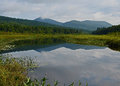 Adirondack wilderness waterway and mountains the kunjamuck river view of dug south Stock Photography