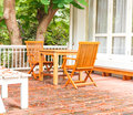 Adirondack wood chairs on a cabin porch Stock Photos