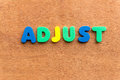 Adjust colorful word on the wooden background Stock Photo