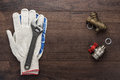 Adjustable wrench gloves and pipes Royalty Free Stock Photo