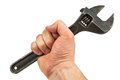 Adjustable wrench in hand Stock Photo