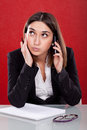 Administrative tired woman speaking on the phone Stock Images