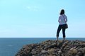 Admiring the atlantic ocean a woman admires from limestone cliffs in ireland Stock Photography