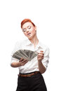 Admiring business woman counting money young caucasian red haired isolated on white Royalty Free Stock Images