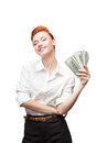 Admiring business woman holding money young caucasian red haired happy smiling isolated on white Royalty Free Stock Photography