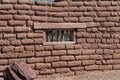 Adobe wall with window Royalty Free Stock Photo