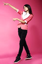 Adolescence young funny asian woman gesturing with her hands fancy over pink Royalty Free Stock Photo