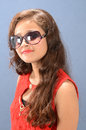 Adolescent beauty an girl with sun glass posing in the studio Stock Photos
