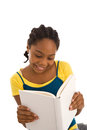 Adolescent female reading a book african ethnicity holding textbook with copy space isolated on white background Stock Image