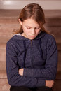 Adolescent girl pouting with her arms folded Royalty Free Stock Photo