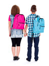 Adolescent love teenage couple with backpack holding hands ready to go back to school Royalty Free Stock Photos