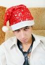 Adolescente cansado em santa hat Imagem de Stock Royalty Free