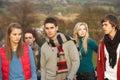 Adolescente rodeado por Friends Fotografía de archivo