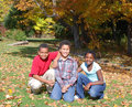 Adoption a multiracial family enjoys a nice fall afternoon Royalty Free Stock Photo