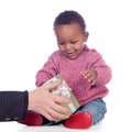 Adorable african american child playing with a gift box isolated on white background Stock Photo