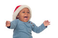 Adorable african baby with christmas hat shouting isolated on a white background Royalty Free Stock Images