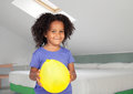 Adorable african little girl with a yellow balloon Royalty Free Stock Photography