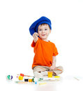 Adorable artist child with color paints on white Royalty Free Stock Photo