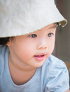 Adorable asian child girl concentrate on travel portrait of wearing hat Royalty Free Stock Photos