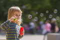 Adorable baby blow soap bubbles Royalty Free Stock Images