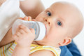 Adorable baby boy drinking from bottle Royalty Free Stock Photos