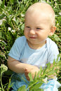 Adorable baby boy outdoors Stock Photos