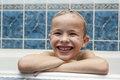 Adorable baby boy with shampoo soap suds on hair taking bath. Cl Royalty Free Stock Photo