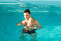 Adorable baby enjoying swimming in a pool with his father Royalty Free Stock Photo