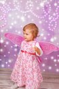 Adorable baby girl with fairy wings Stock Photos
