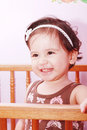 Adorable baby girl in nursery Stock Image