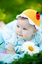 Adorable baby girl outdoors in the grass Royalty Free Stock Images