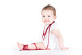 Adorable baby girl playing with a necklace Royalty Free Stock Photo