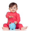 Adorable baby girl sitting with a blue piggy-bank Royalty Free Stock Photo