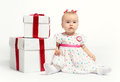 Adorable baby girl with two gift boxes Royalty Free Stock Image