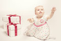 Adorable baby girl with two gift boxes Royalty Free Stock Photo
