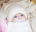 Adorable baby girl wearing winter hat white Stock Photo