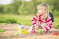 Adorable baby play with toys on sandbox Royalty Free Stock Photography