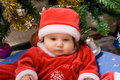 Adorable baby in red costume Stock Photo