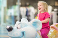 Adorable baby ride on carousel in mall Royalty Free Stock Photo