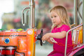 Adorable baby ride on toy truck in mall Royalty Free Stock Photography