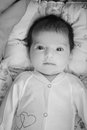 Adorable beautiful newborn baby looking up with a look of wonderment Stock Photo